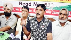 Ex-Central Paramilitary Forces personnel addressing a press conference in Jammu on Tuesday.        -Excelsior/Rakesh