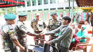 Officers and jawans of RR at a Medical camp at Udhampur on Friday.