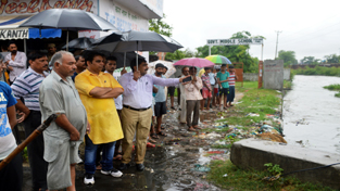 MLA R S Pura Gagan Bhagat during his visit to water logged areas of R S Pura on Wednesday.