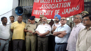 DC Jammu, Simrandeep Singh announcing about agreement between JU and NGEU on Wednesday in presence of Vice-Chancellor, DIG Jammu - Kathua Range and employees leaders.