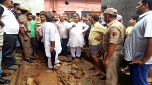 BJP State chief, Sat Sharma during his visit to flood hit area of Janipura on Wednesday.