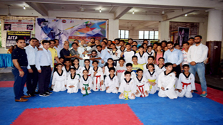 Winners in various categories of 1st J&K Taekwondo Association Cup posing for a group photograph.