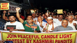 KP leaders during candle light procession at Jammu on Saturday.