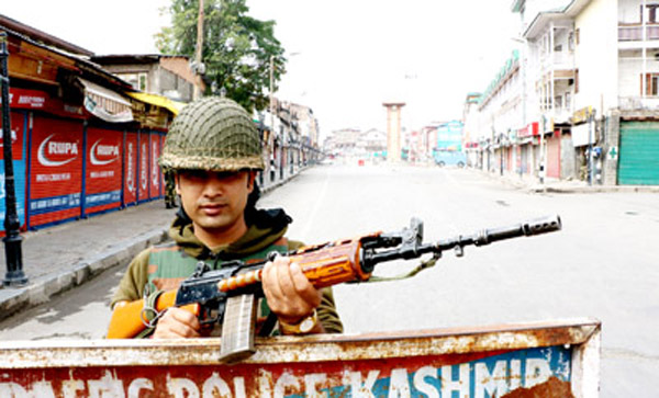 A BSF soldier patrols Lal Chowk during curfew in Srinagar on Friday.    —Excelsior/Shakeel