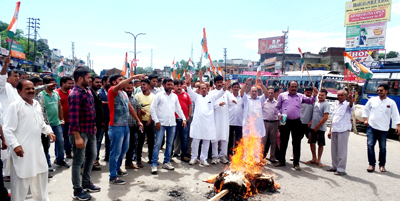 Congress workers protesting against BJP at Samba on Wednesday.