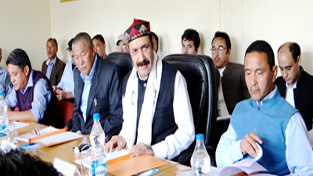 Minister for Revenue, Syed Basharat Bukhari chairing a meeting at Leh on Friday.