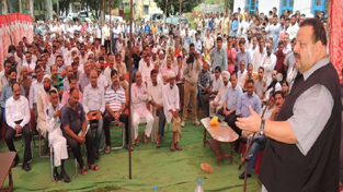 MLA Nagrota, Devender Singh Rana addressing gathering at Dansal on Saturday.