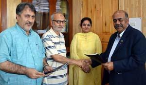 Minister for Education, Naeem Akhtar along with MoS Priya Sethi during signing of MoU at Srinagar on Wednesday.