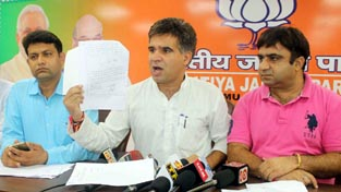 MLA Nowshera, Ravinder Raina addressing a press conference at Jammu on Wednesday.    —Excelsior/Rakesh