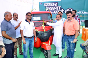 MLA Hiranagar unveiling Maxima-C cargo vehicle during customers meet at NSF Bajaj.