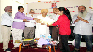 MLC Ashok Khajuria and others presenting certificate to a participant during conclusion of National Level Women Painters' Camp by JKCCA on Sunday.