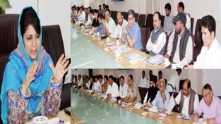 Chief Minister, Mehbooba Mufti chairing a high-level meeting regarding State Hajj Committee arrangements at Srinagar on Friday.