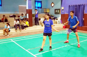 Players in action during a match in All J&K Badminton Tournament.