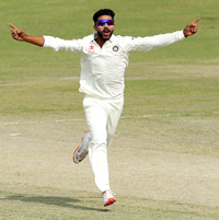 Ravindra Jadeja celebrates after taking a wicket during a Duleep Trophy match.
