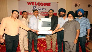 Officials of Relaxo Home Appliances during the launch of new range of products at Jammu.