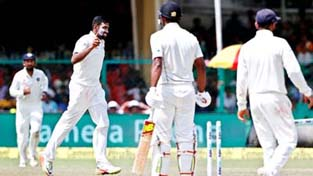 Ravichandran Ashwin celebrates after claiming the wicket of New Zealand's Ish Sodhi on the fifth day of their first cricket test match at Green Park Stadium in Kanpur on Monday.