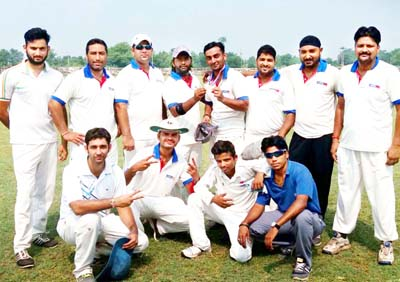 Winner Media XI team posing for a group photograph on Saturday.