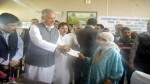 R&B Minister Abdul Rehman Veeri distributing cheques among beneficiaries of IAY and SBM in Anantnag on Sunday. -Excelsior/ Sajad Dar
