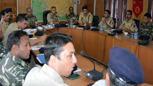 Special DG, Law & Order S P Vaid chairing a meeting of police and CRPF officers in Pulwama on Saturday.
