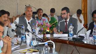 Minister for Public Works Abdul Rehman Veeri chairing a meeting at Anantnag on Monday.