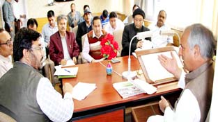 Minister for Public Works Abdul Rehman Veeri chairing a meeting in Srinagar on Tuesday.
