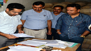 Minister for FCS&CA, Choudhary Zulfkar Ali inspecting records at Akhnoor on Monday.