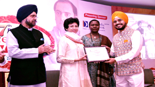 H S Paul of Daily Excelsior receiving award from former Union Minister Kumari Selja, MP at a function organized by Pehchan- NGO.
