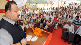 NC provincial president Devender Singh Rana addressing a gathering at Nagrota on Monday.