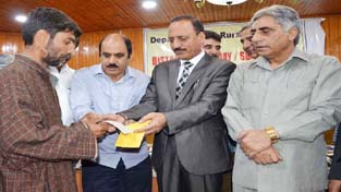 Minister for Rural Development, Abdul Haq and Minister for Agriculture Ghulam Nabi Lone distributing cheques to beneficiaries of IAY and Swacch Bharat Mission on Tuesday.