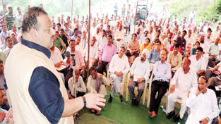 NC Provincial President Devender Singh Rana addressing Public Grievances Redressal Camp on Wednesday.