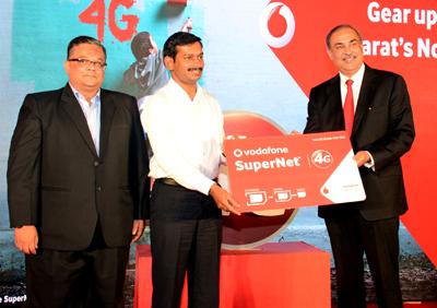 Jayesh Gadia Business Head-Gujarat Vodafone India, Milind Torawane, Municipal Commissioner Surat, Sunil Sood, MD CEO Vodafone India at launching of 4G service.