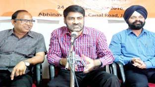 Balwant Thakur talking to media persons on Thursday.  -Excelsior/Rakesh