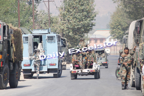 Security forces rush to JKEDI complex in Pampore, where gunbattle in on with militants : Excelsior Photo