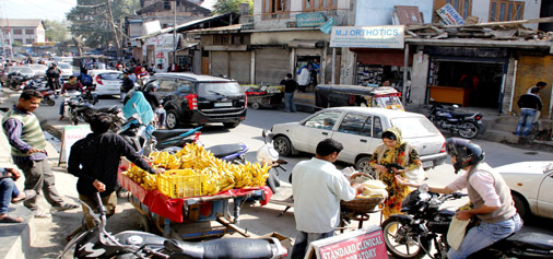 A vendor selling fruits outside a hospital in Old City's Rainawari as curfew was lifted from some parts of Srinagar on Thursday. -Excelsior/ Shakeel