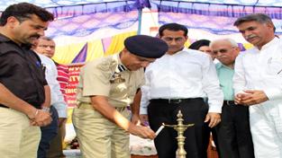 DIG Jammu - Kathua range, Ashkoor Ahmed Wani lighting ceremonial lamp to inaugurate Mega Disability Board Camp.