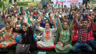 Home Guards staging protest dharna at Jammu on Friday. -Excelsior/ Rakesh