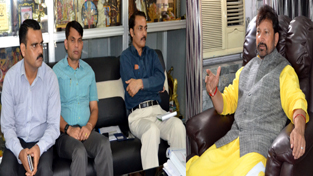 Minister for Forest Ch. Lal Singh interacting with officers at Jammu on Thursday.
