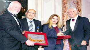 Atul Modi, MD, Prevest Denpro Limited and Namrate Modi receiving 'Best Enterprise' award.