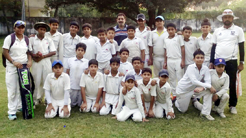 Jammu-A and Jammu-B players posing for group photograph after their match at Mayank Goswami Cricket Academy Jammu on Sunday.