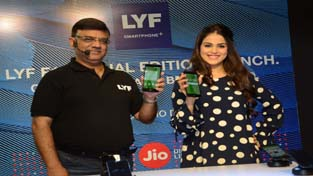 Bollywood actress, Genelia D'Souza along with an official of Reliance Retail (Devices) during the launch of LYF F1 in Mumbai.