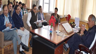 Minister for Public Works Abdul Rehman Veeri chairing a meeting at Srinagar on Thursday.