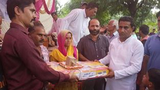 MLA Kathua Rajiv Jasrotia distributing LPG stoves among BPL women at Kathua on Friday.