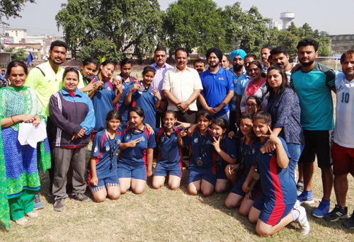 Medal winners posing for photograph with MLA Akhnoor Rajiv Sharma and DC Jammu Simrandeep Singh.