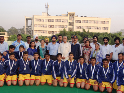 Winners posing for group photograph with MP, SS Manhas, DC Jammu Simrandeep Singh and others.