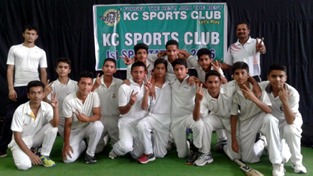 Winning team posing for a group photograph.