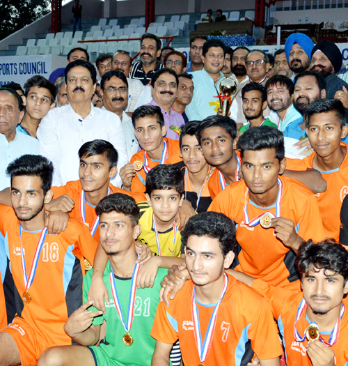 J&K Bank players receiving title trophy from DyCM Dr Nirmal Singh and MLA Jammu East Rajesh Gupta.