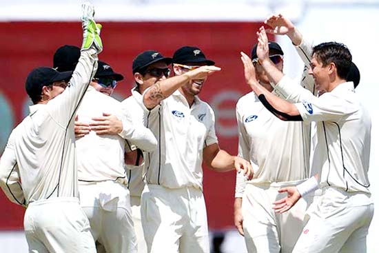 Trent Boult celebrates the wicket of Virat Kohli during the first day of second test at Kolkata.