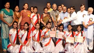 Deputy Chief Minister Dr Nirmal Singh distributing prize at Abhinav Theatre on Saturday.