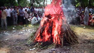 Martyr Gurnam Singh's body being consigned to flames at his native village Bhalesar in R S Pura on Monday.  -Excelsior/ Rakesh