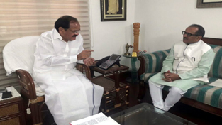 Deputy Chief Minister Dr Nirmal Singh interacting with Union Minister Venkaiah Naidu at New Delhi on Tuesday.